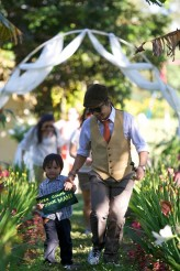 The ring bearer also carried a sign saying HERE COMES YOUR MAN
