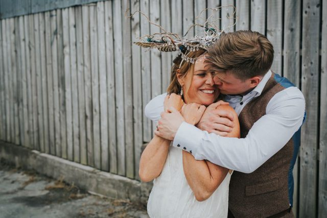 Cool Tattooed B&G Wedding at FForest wearing headpiece(s) from Curious Fair